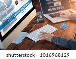 woman using computer smartphone ... | Shutterstock . vector #1016968129