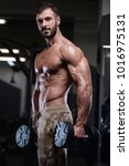 sexy strong bodybuilder... | Shutterstock . vector #1016975131