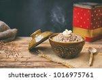 hot buckwheat porridge with... | Shutterstock . vector #1016975761