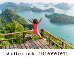 woman tourist jumping with... | Shutterstock . vector #1016990941