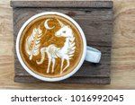 A Cup Of Coffee With Latte Art...