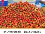 red strawberries background.   Shutterstock . vector #1016998369