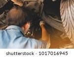 mechanic in uniform lying down... | Shutterstock . vector #1017016945