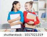 cute smiling schoolgirls with... | Shutterstock . vector #1017021319