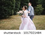 the bride and groom are running ... | Shutterstock . vector #1017021484