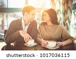 the happy couple drink a coffee ... | Shutterstock . vector #1017036115