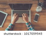 man is working by using a...   Shutterstock . vector #1017059545