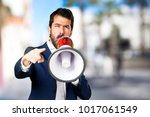 handsome man shouting by... | Shutterstock . vector #1017061549