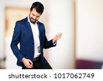 handsome man making guitar... | Shutterstock . vector #1017062749