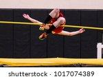 a high school high jumper... | Shutterstock . vector #1017074389