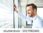 businessman looking though the... | Shutterstock . vector #1017082681
