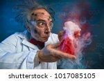 wacky scientist with explosive... | Shutterstock . vector #1017085105