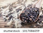 dried spice cloves in spoon on... | Shutterstock . vector #1017086059