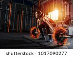 athletic girl works out at the... | Shutterstock . vector #1017090277