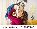 mom and daughter are at home in ... | Shutterstock . vector #1017097465