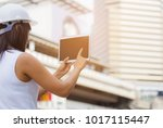 engineer holding tablet... | Shutterstock . vector #1017115447