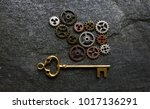 assorted gears with gold key on ... | Shutterstock . vector #1017136291