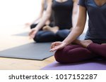 women practicing yoga together...   Shutterstock . vector #1017152287