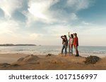 best friends near the coastline ... | Shutterstock . vector #1017156997