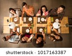 group of friends at a... | Shutterstock . vector #1017163387