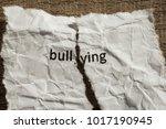 torn paper written bullying... | Shutterstock . vector #1017190945