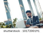 businessman sitting in a... | Shutterstock . vector #1017200191