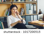 pregnant business woman working ... | Shutterstock . vector #1017200515