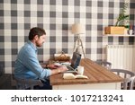 focused young man working alone ... | Shutterstock . vector #1017213241