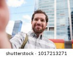 smiling young man with a beard... | Shutterstock . vector #1017213271