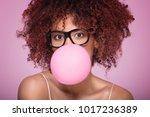 afro girl blowing a bubble gum... | Shutterstock . vector #1017236389