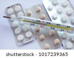 pills and thermometr   Shutterstock . vector #1017239365