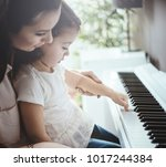 beautiful young mother with her ... | Shutterstock . vector #1017244384