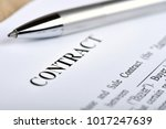 Small photo of Legal contract signing - buy sell real estate contract