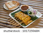 pork satay skewered with bamboo ... | Shutterstock . vector #1017250684