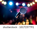 Small photo of Public performance on stage Microphone on stage against a background of auditorium. Shallow depth of field. Public performance on stage.