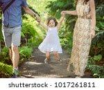 happy family having fun outdoors | Shutterstock . vector #1017261811