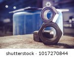 Hexagon Nuts Metalworking Industry Concept. Three Large Metal Nuts Closeup Photo. - stock photo