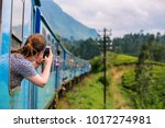 young woman enjoying train ride ... | Shutterstock . vector #1017274981