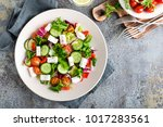 fresh vegetable salad with feta ... | Shutterstock . vector #1017283561
