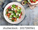 fresh vegetable salad with feta ... | Shutterstock . vector #1017283561