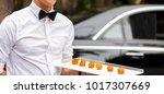 waiter serving appetizers at a... | Shutterstock . vector #1017307669