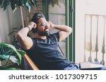 handsome bearded man in... | Shutterstock . vector #1017309715