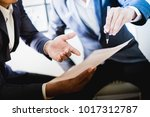 business partners discussing... | Shutterstock . vector #1017312787