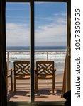 view of the open balcony doors... | Shutterstock . vector #1017350755