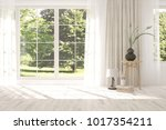 white empty room with decor and ... | Shutterstock . vector #1017354211