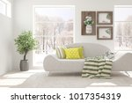 white room with sofa and winter ... | Shutterstock . vector #1017354319