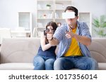 young family playing games with ... | Shutterstock . vector #1017356014
