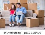 young pair moving in to new... | Shutterstock . vector #1017360409