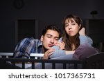 young parents sleepless with... | Shutterstock . vector #1017365731