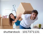 young family unpacking at new... | Shutterstock . vector #1017371131